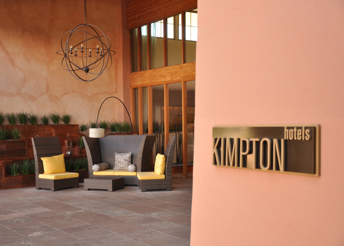 Kimpton Logo sign at entrance to Hotel. Sign is machined and painted aluminum.