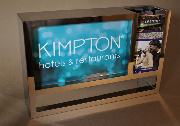 Mirror polished metal literature rack for reception desk at Kimpton Hotels