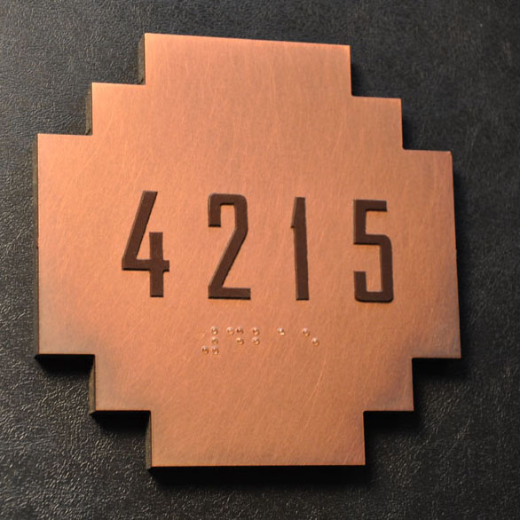 Final guestroom sign. Copper with oxidized finish, hand applied non directinal finish, and satin clearcoat.